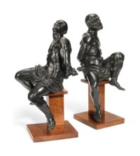 A PAIR OF BRONZE MODELS OF SLAVES