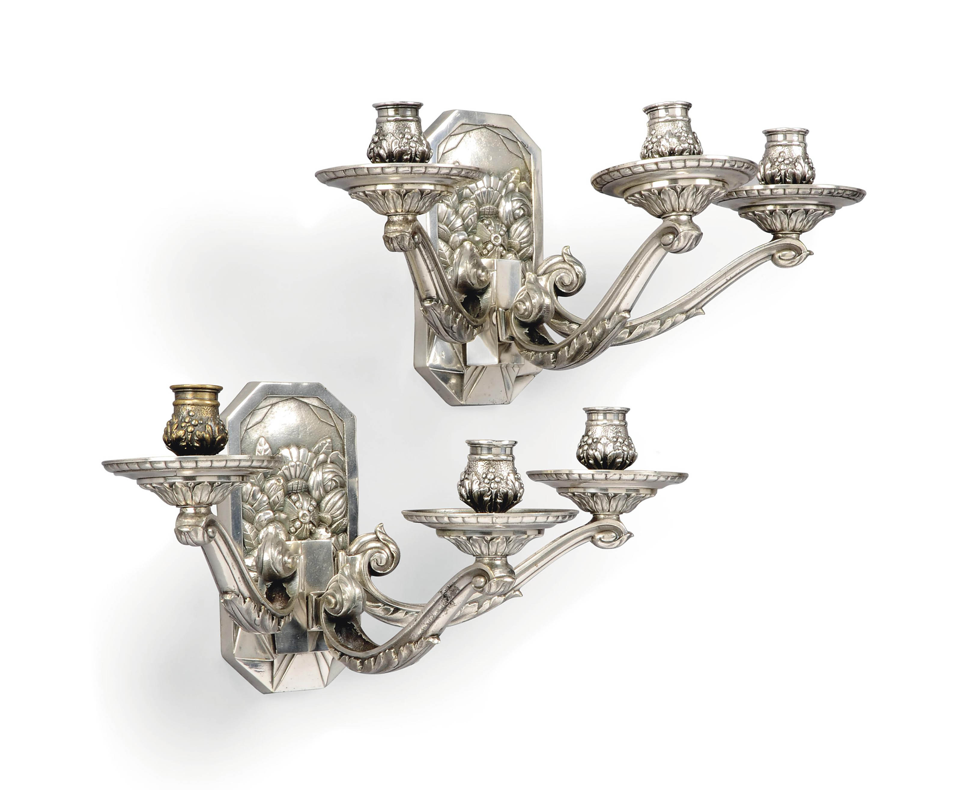 A PAIR OF ART DECO SILVERED BR