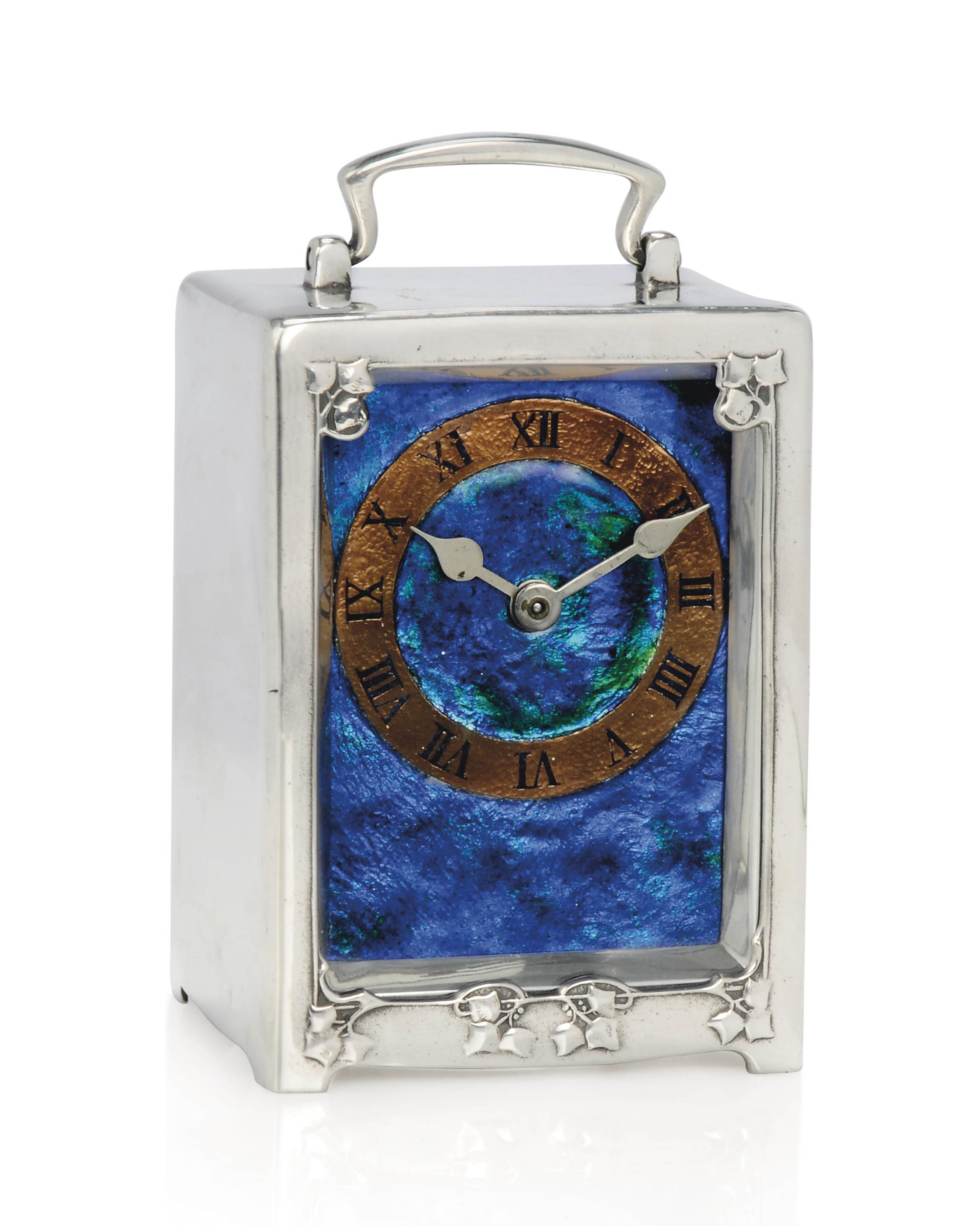 AN ARCHIBALD KNOX, ATTRIBUTED, FOR LIBERTY & CO 'TUDRIC' PEWTER, ENAMEL AND COPPER TIMEPIECE