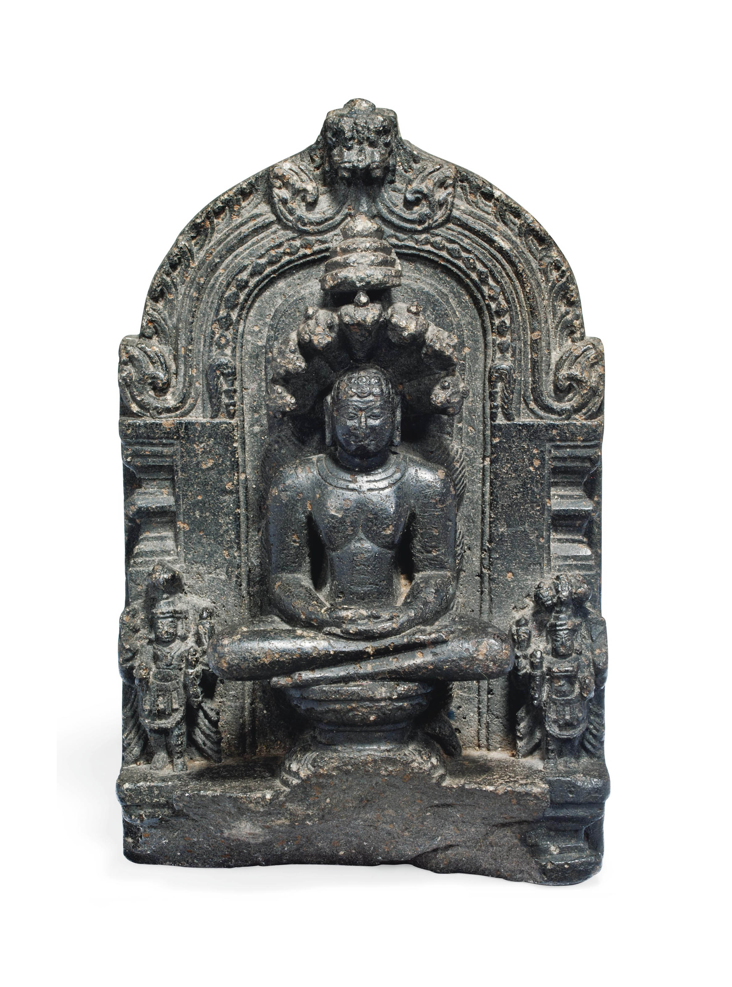 A CARVED STONE RELIEF OF A SEATED JINA