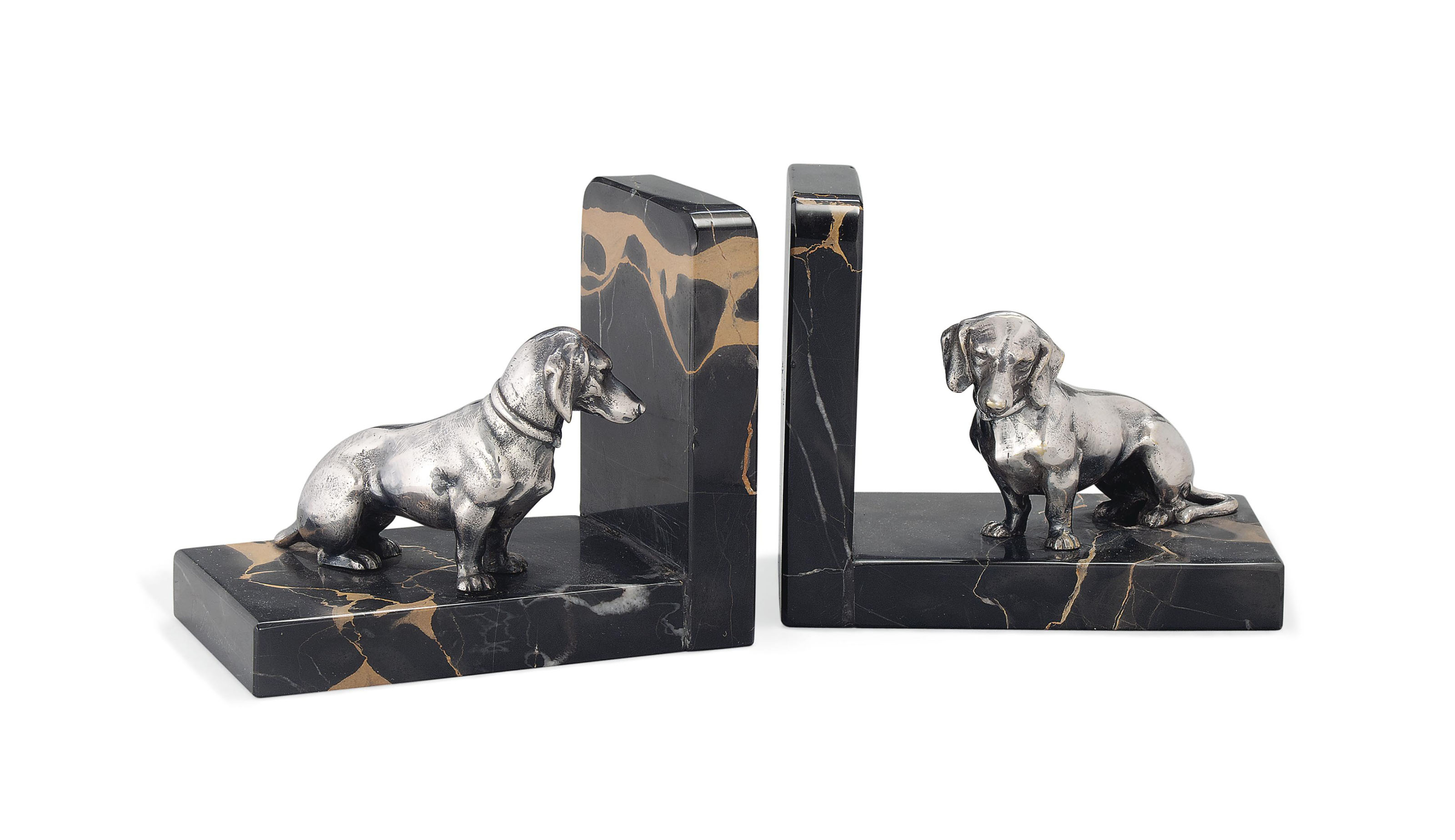 A PAIR OF LECOURTIER SILVERED BRONZE 'DACHSUND' BOOKENDS