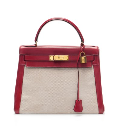 A RED LEATHER AND TOILE KELLY