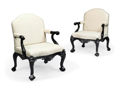 A PAIR OF EBONISED OPEN ARMCHA