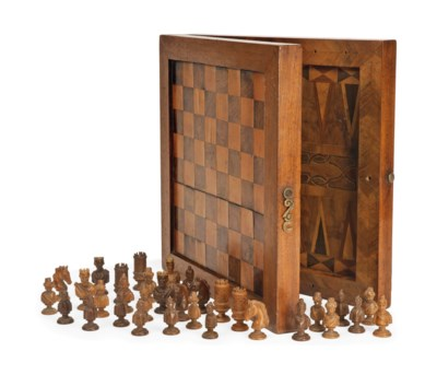 A CARVED WOOD CHESS SET AND IN