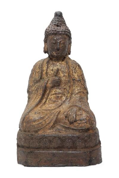 A CHINESE IRON BUDDHA