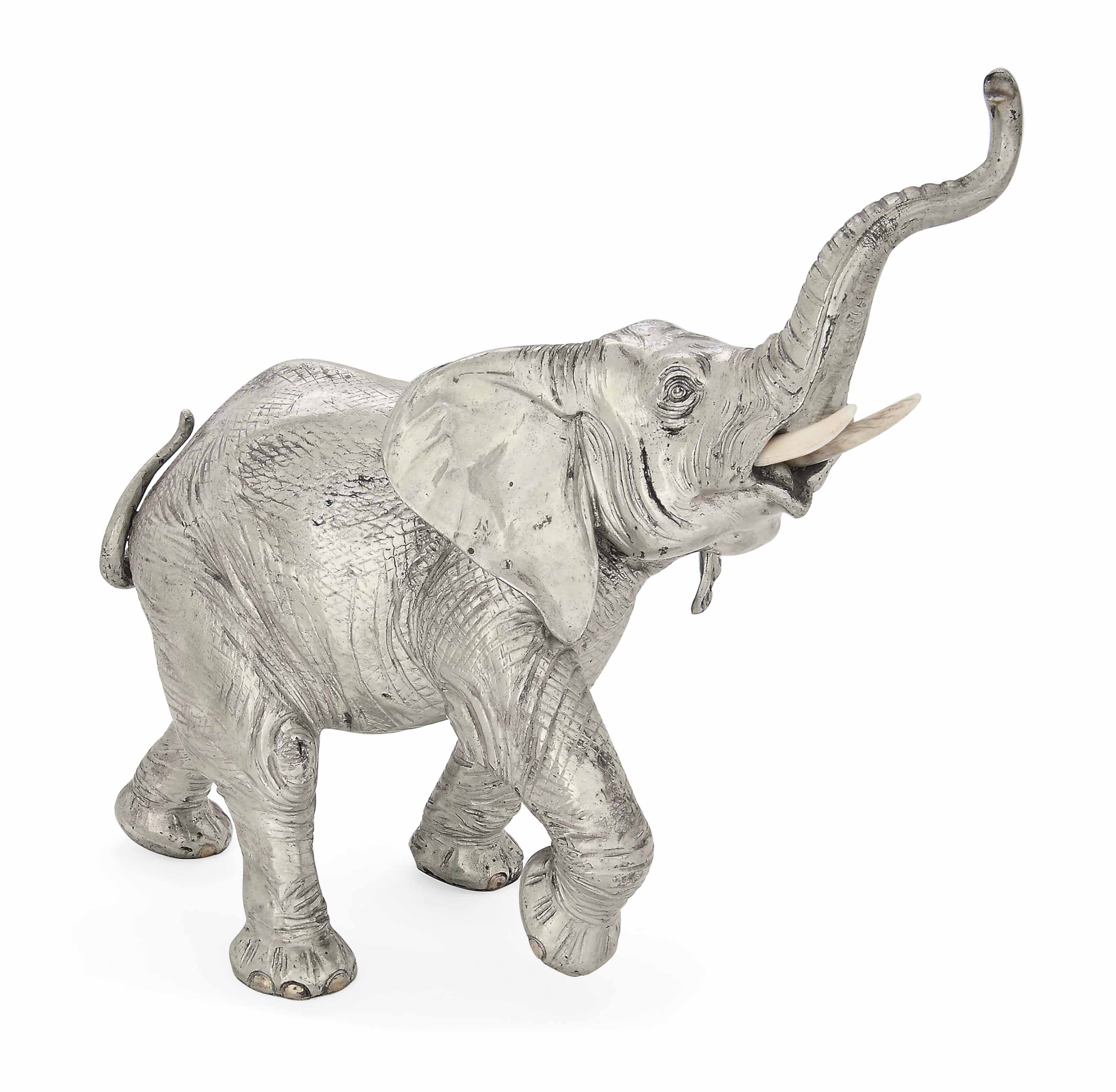 A GERMAN SILVER MODEL OF A CHARGING ELEPHANT