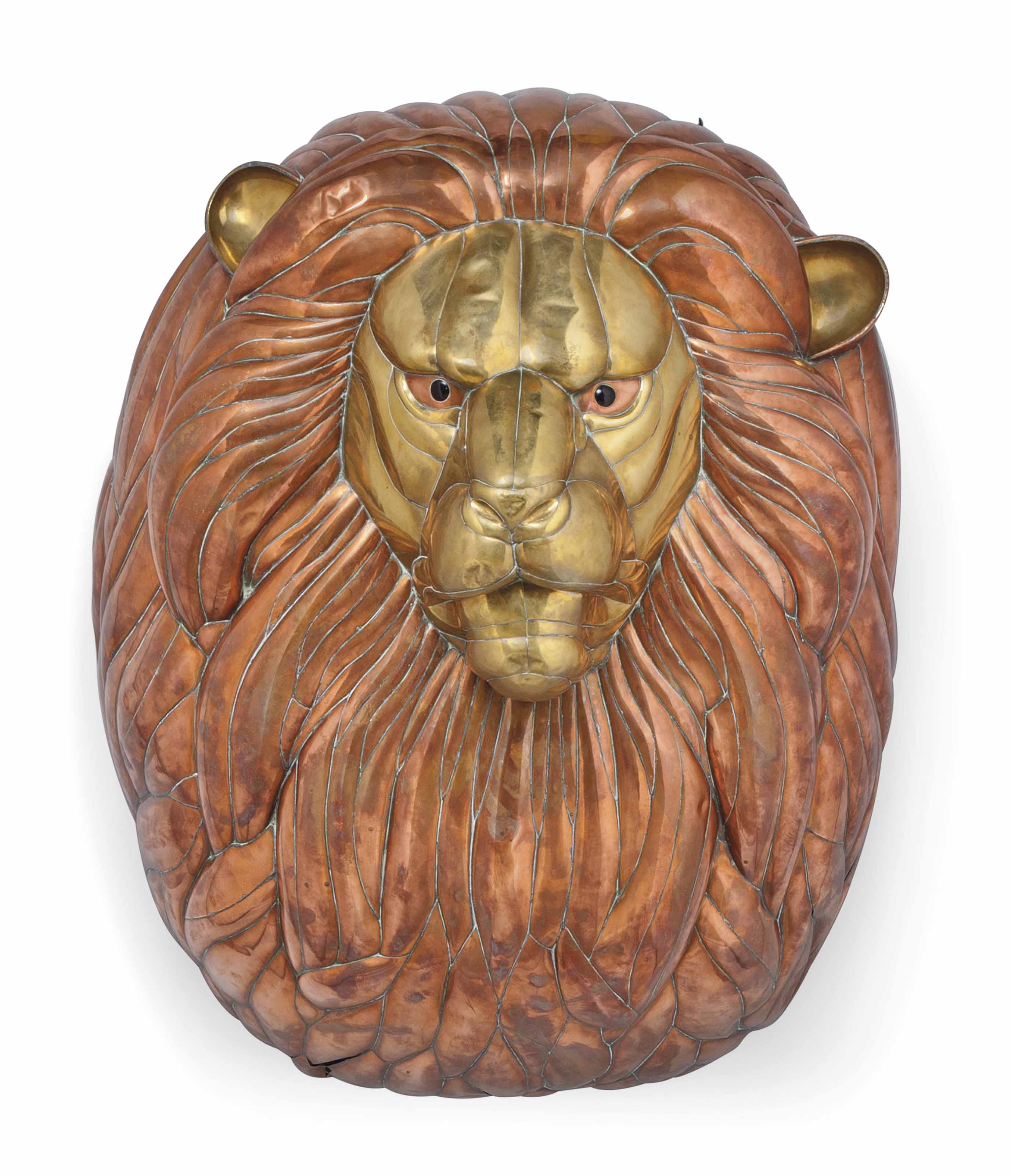 A LARGE COPPER AND BRASS LION