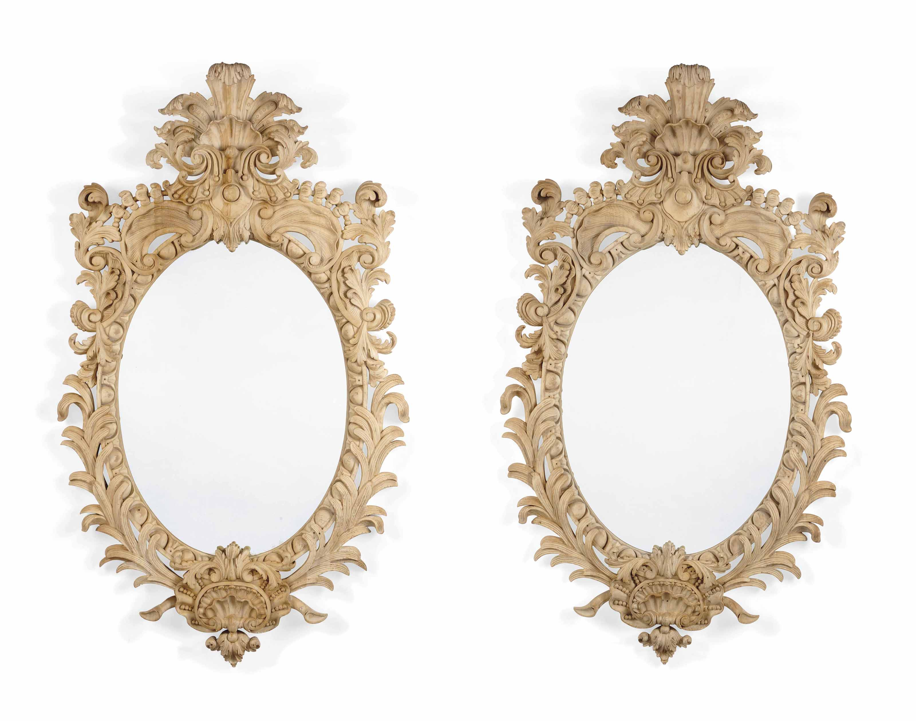 A PAIR OF CREAM-PAINTED MIRROR