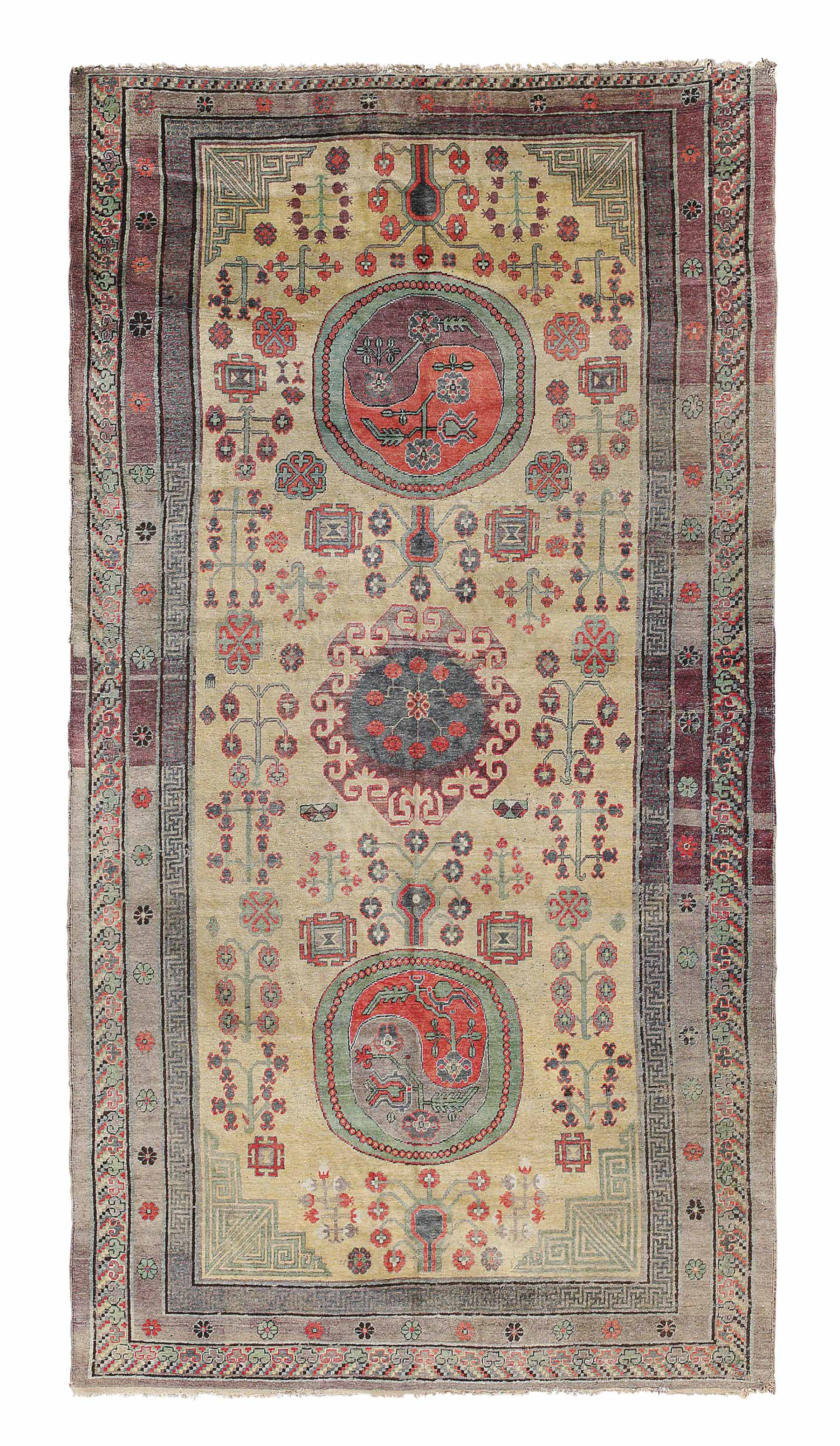 A KHOTAN CARPET, EAST TURKESTA