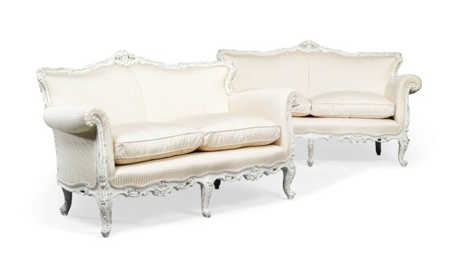 A PAIR OF WHITE PAINTED SOFAS