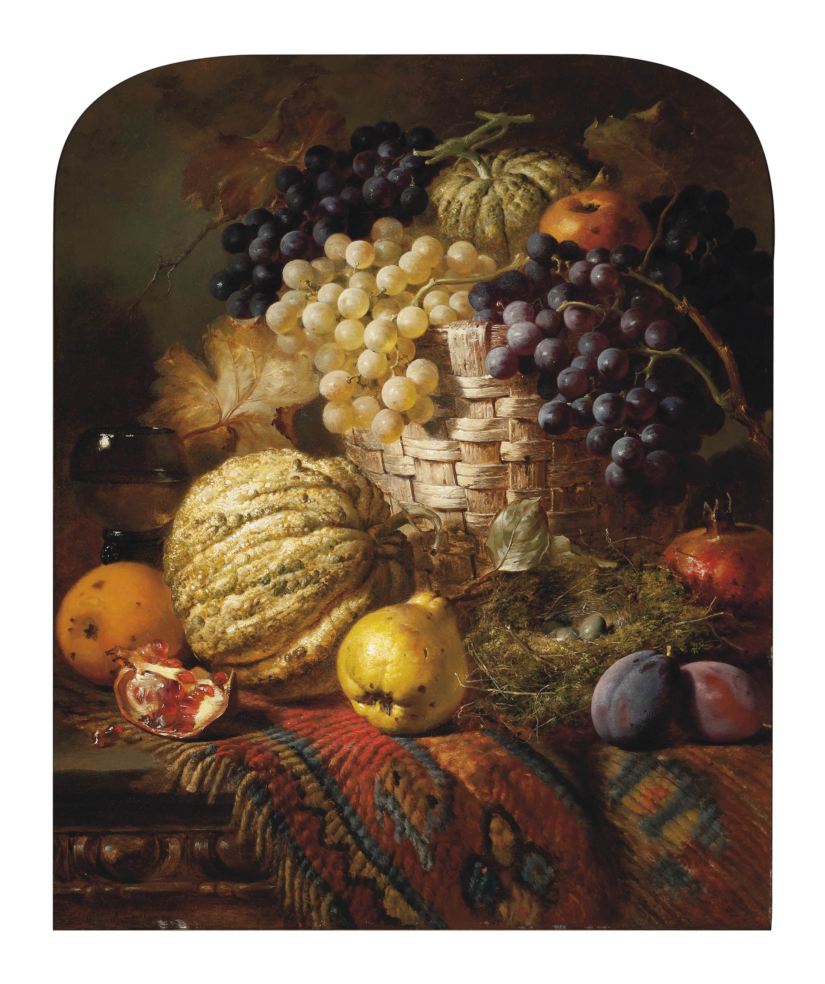 Fruit, a roemer, a wicker basket and bird's nest on a wooden table
