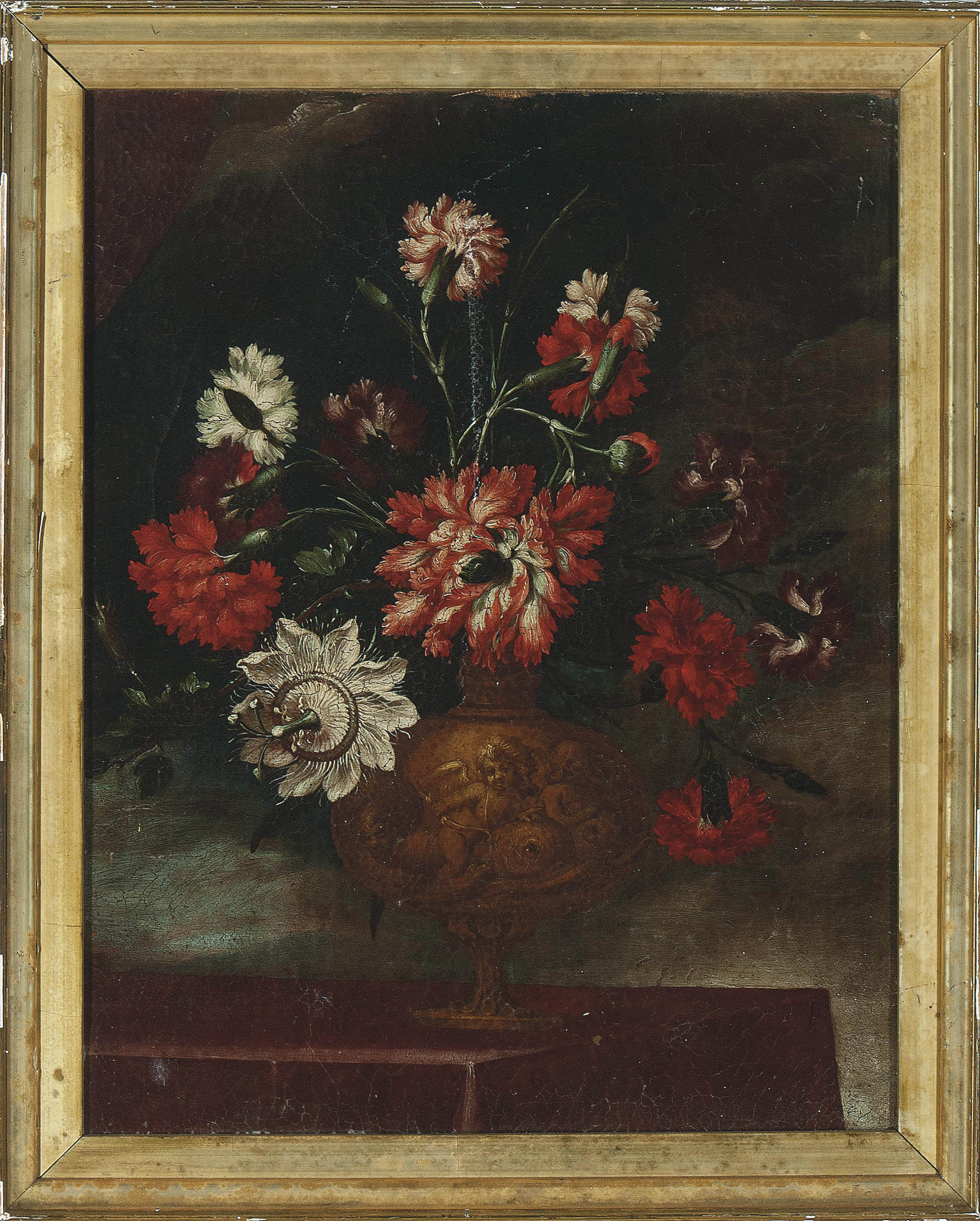 Carnations and passion flowers in an urn on a ledge