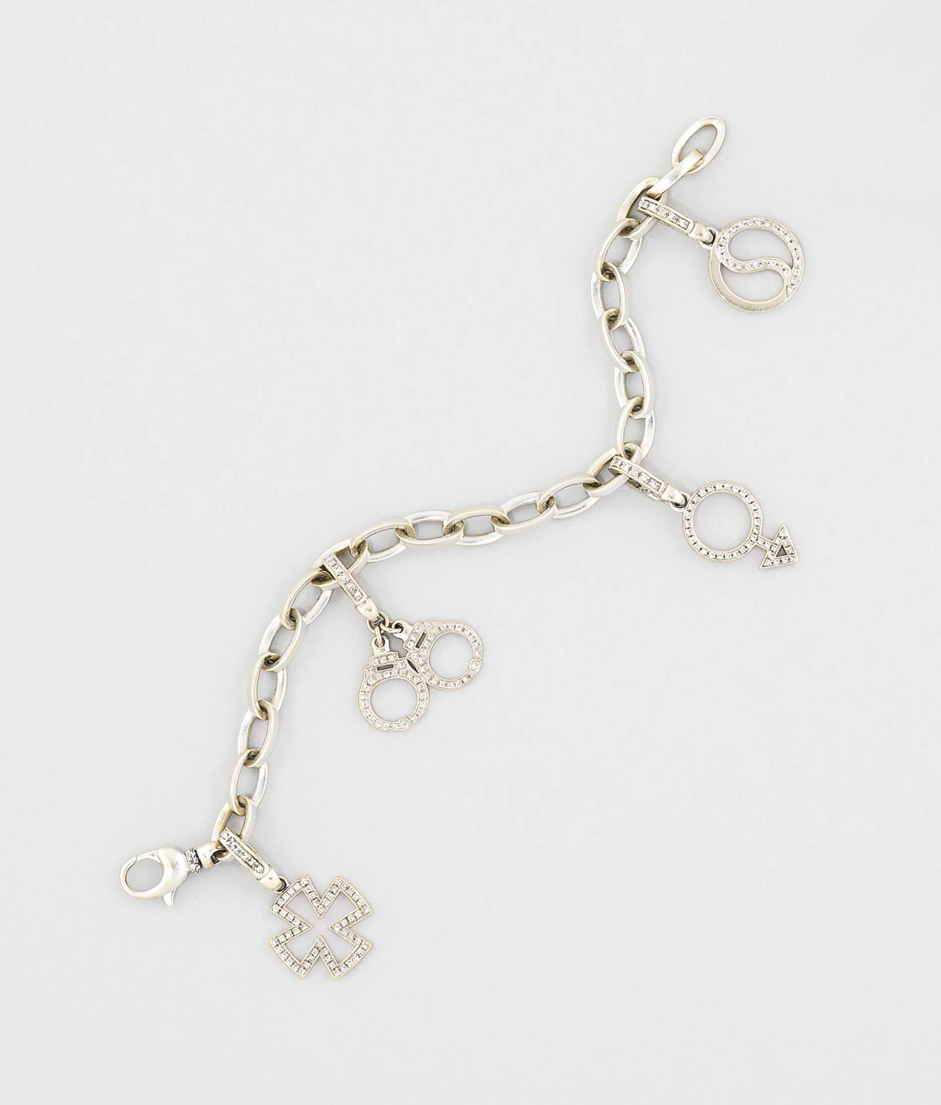A diamond charm bracelet, by T
