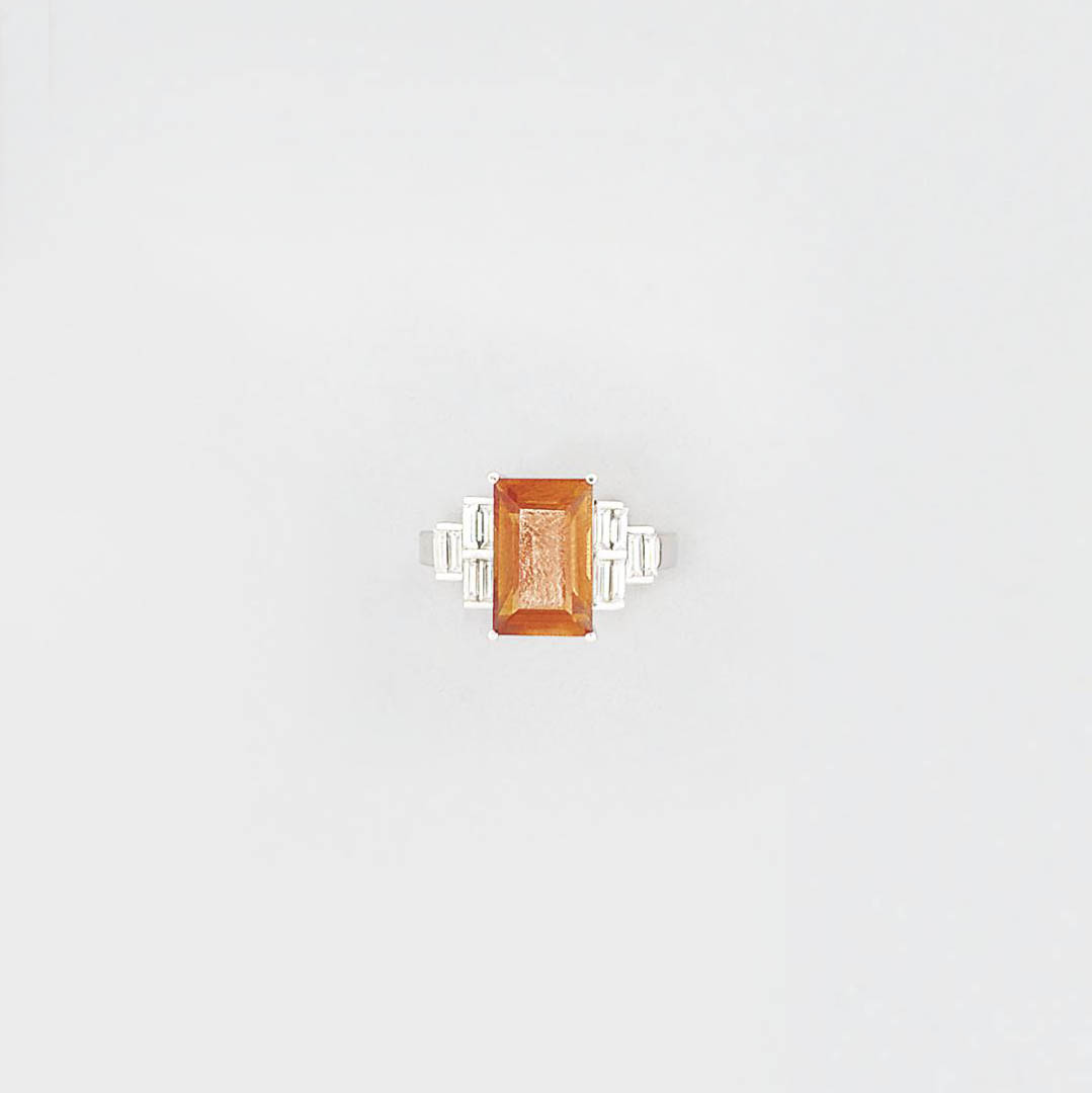 An orangy-yellow sapphire and