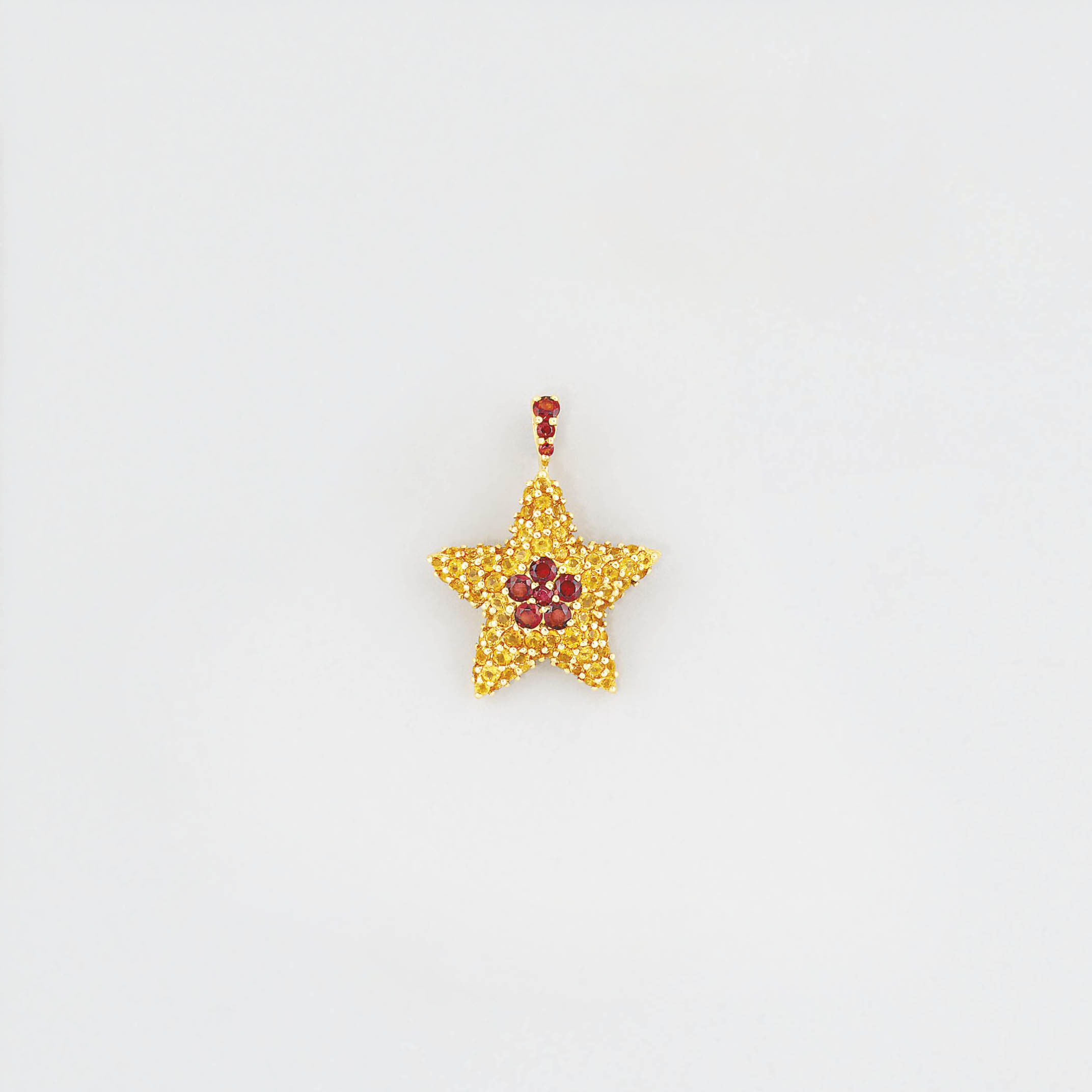 A citrine brooch/pendant, by F