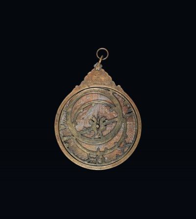 A DECORATIVE ASTROLABE WITH IS