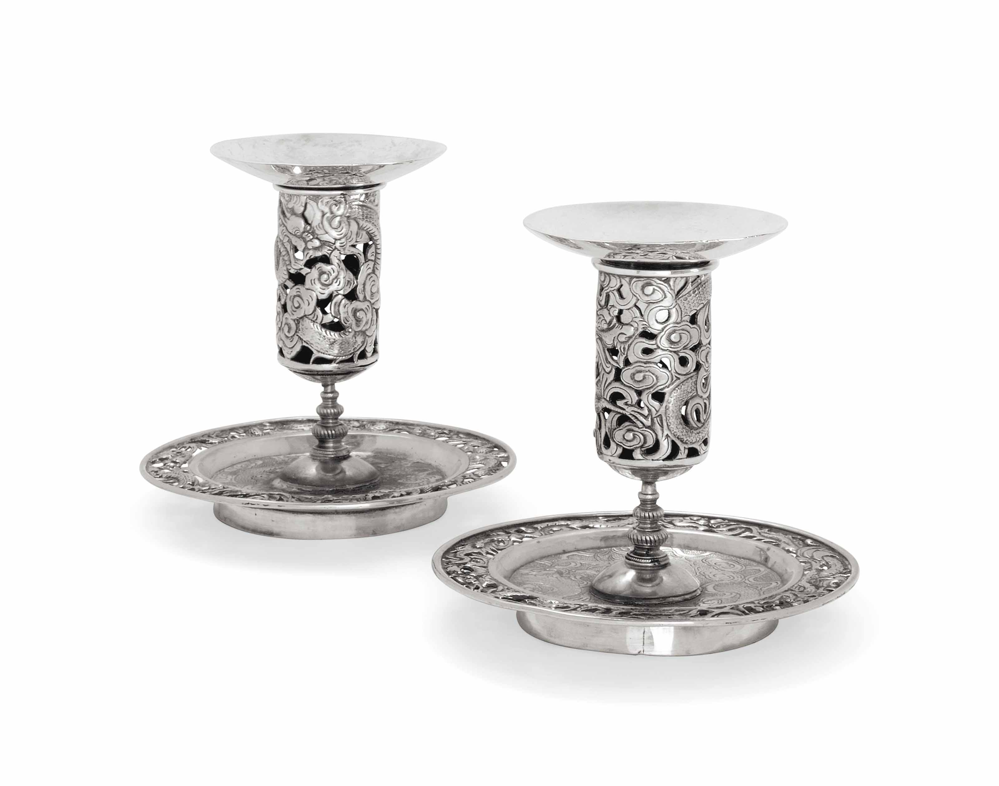 A MATCHED PAIR OF CHINESE SILVER DWARF CANDLESTICKS