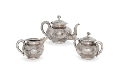 A CHINESE SILVER THREE-PIECE T