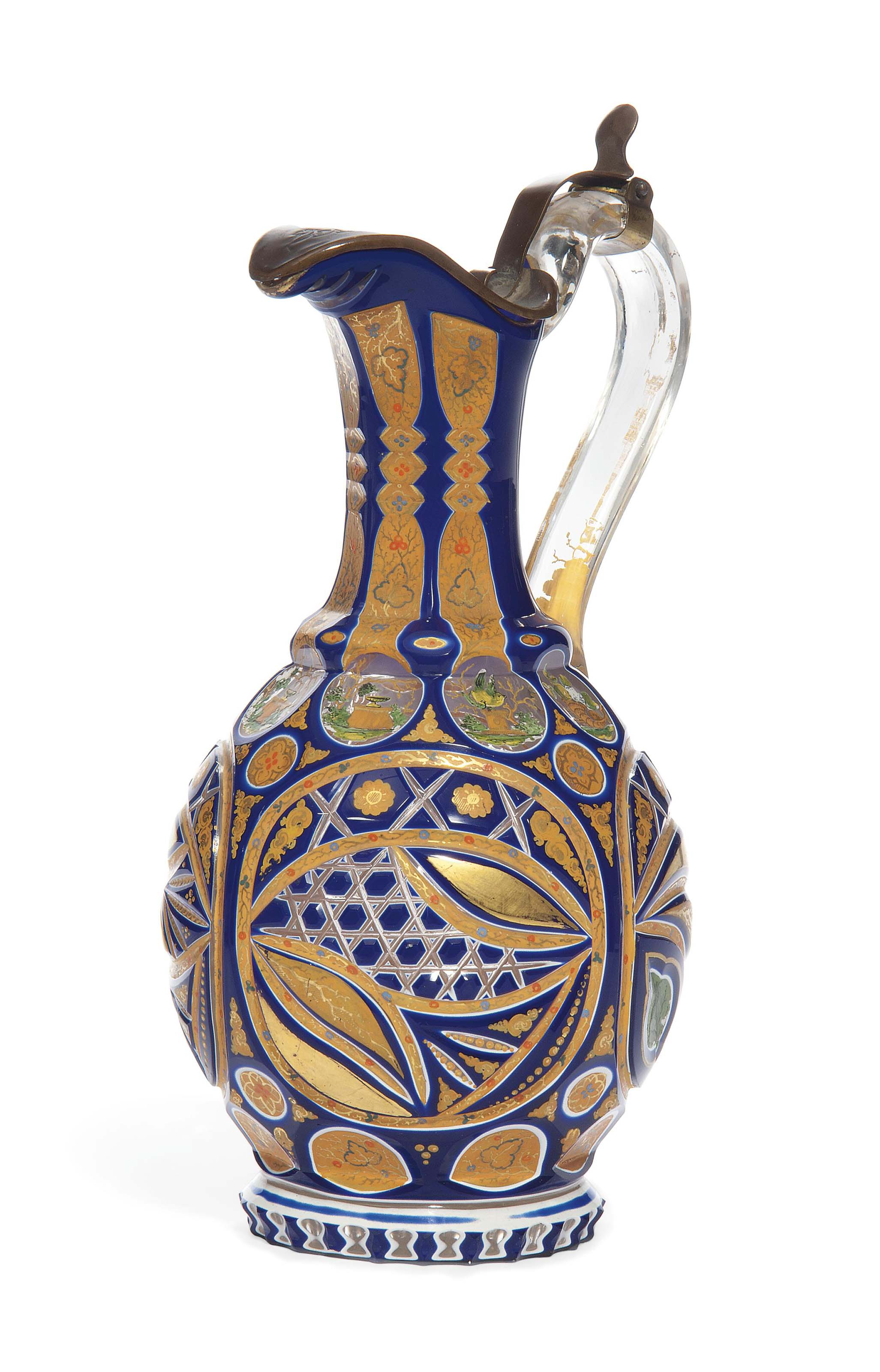 A BOHEMIAN CLEAR-FLASH WHITE AND BLUE-OVERLAY CUT AND ENAMELLED GLASS EWER