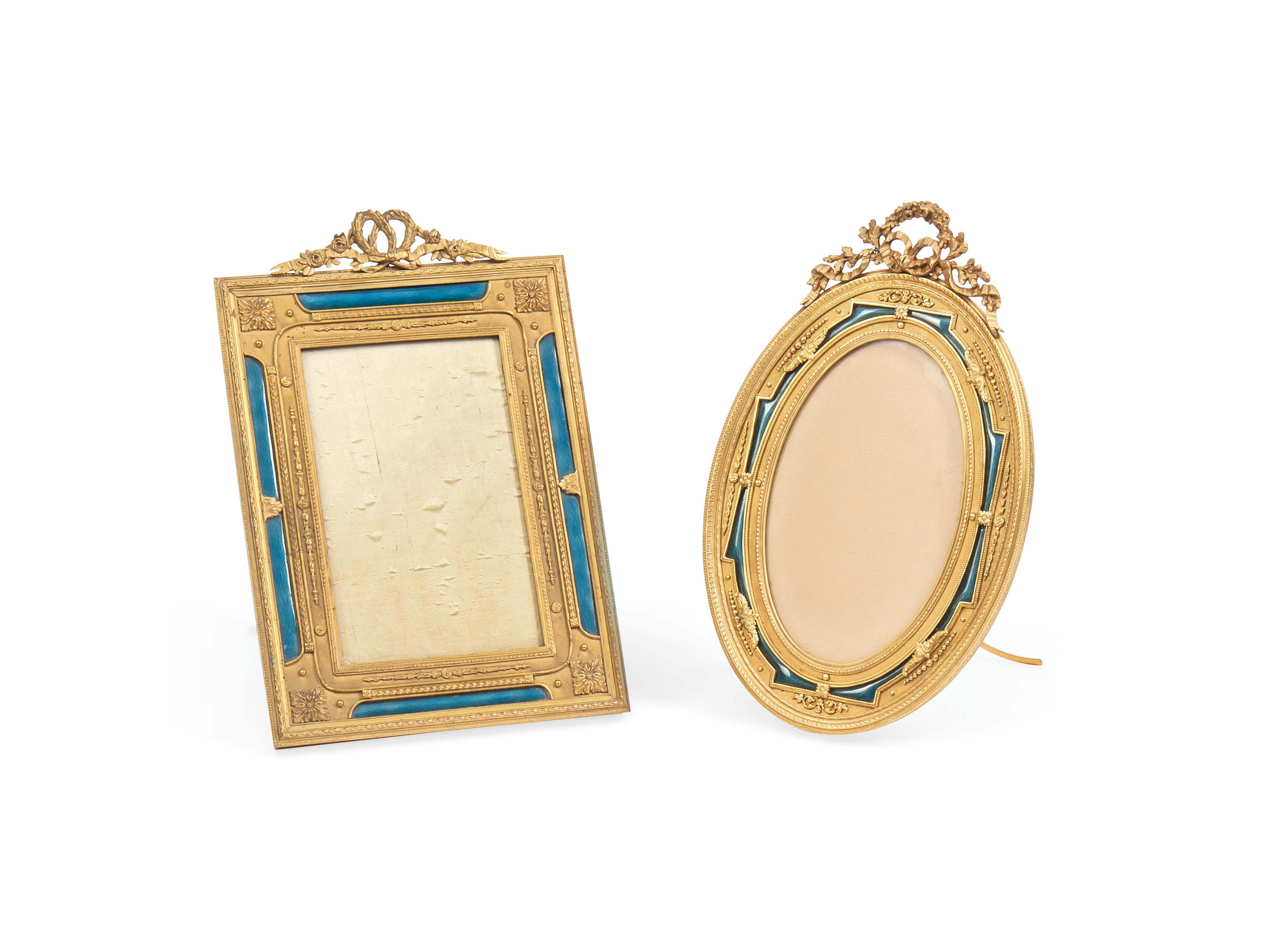 TWO FRENCH GILT BRONZE AND ENAMEL PHOTOGRAPH FRAMES