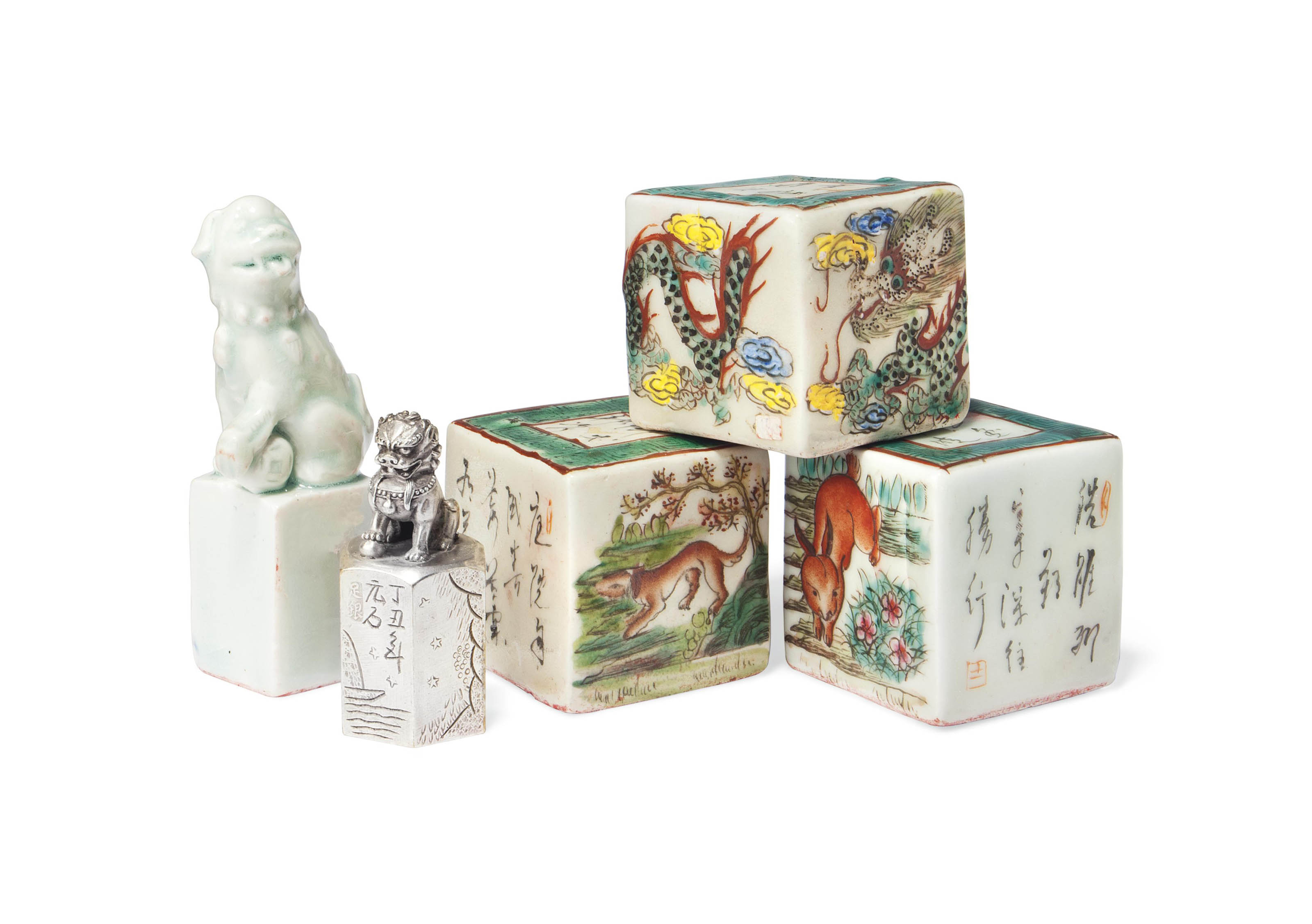 FOUR CHINESE PORCELAIN SEALS AND A SILVER SEAL