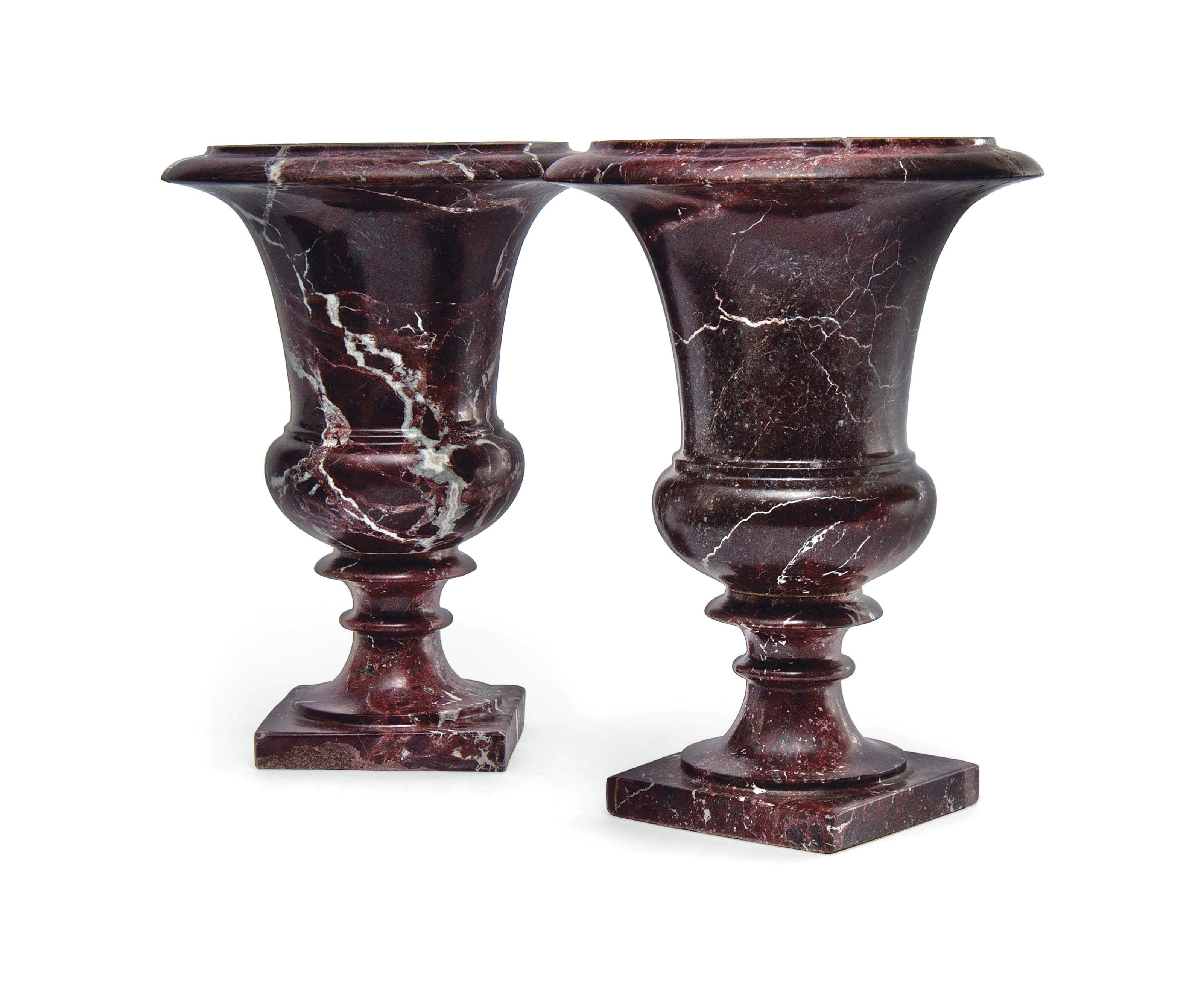A PAIR OF CONTINENTAL 'ROUGE ROYALE' MARBLE URNS