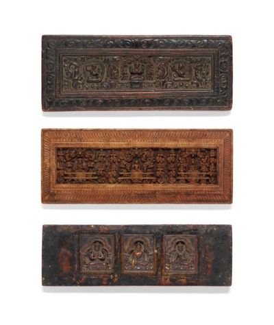 THREE CARVED WOODEN MANUSCRIPT