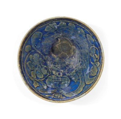 A CALLIGRAPHIC POTTERY BOWL