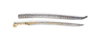 A GOLD-DAMASCENED WALRUS IVORY