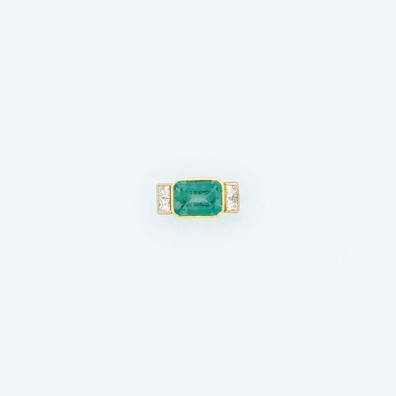 An 18ct gold, emerald and diam