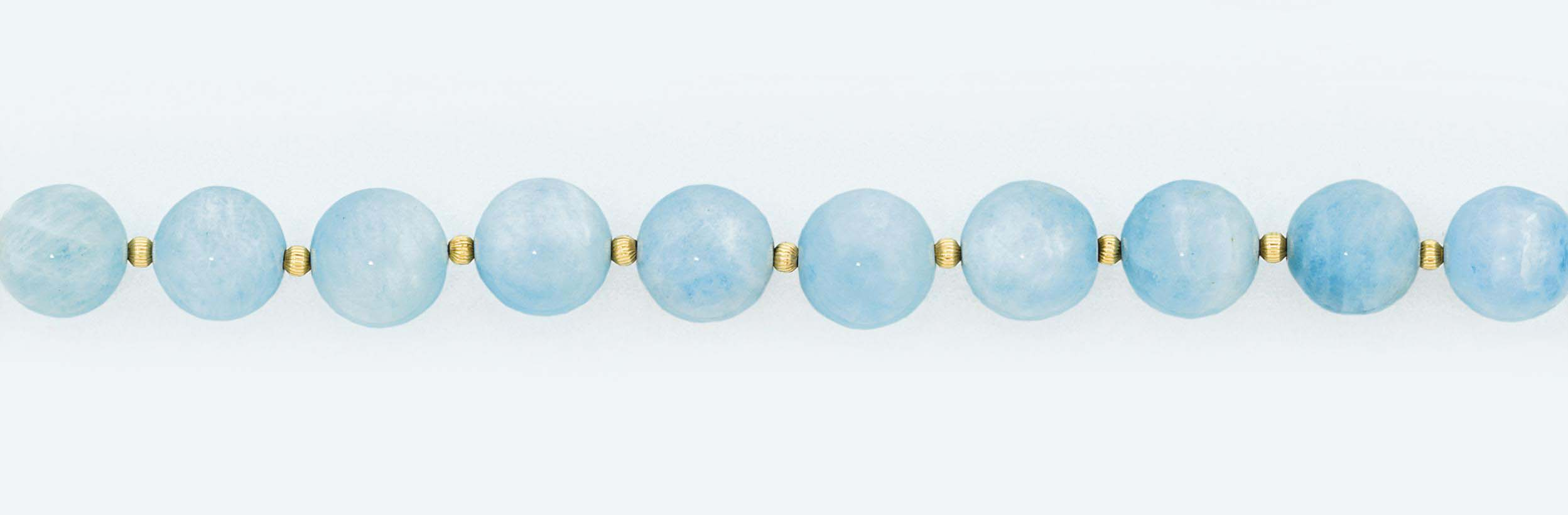 An aquamarine bead necklace an