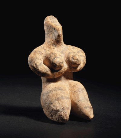 A SYRIAN TERRACOTTA FEMALE FIG