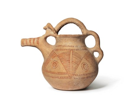 A NEAR EASTERN POTTERY SPOUTED