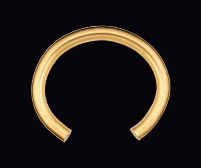 A CELTIC SOLID GOLD-ALLOY INGO