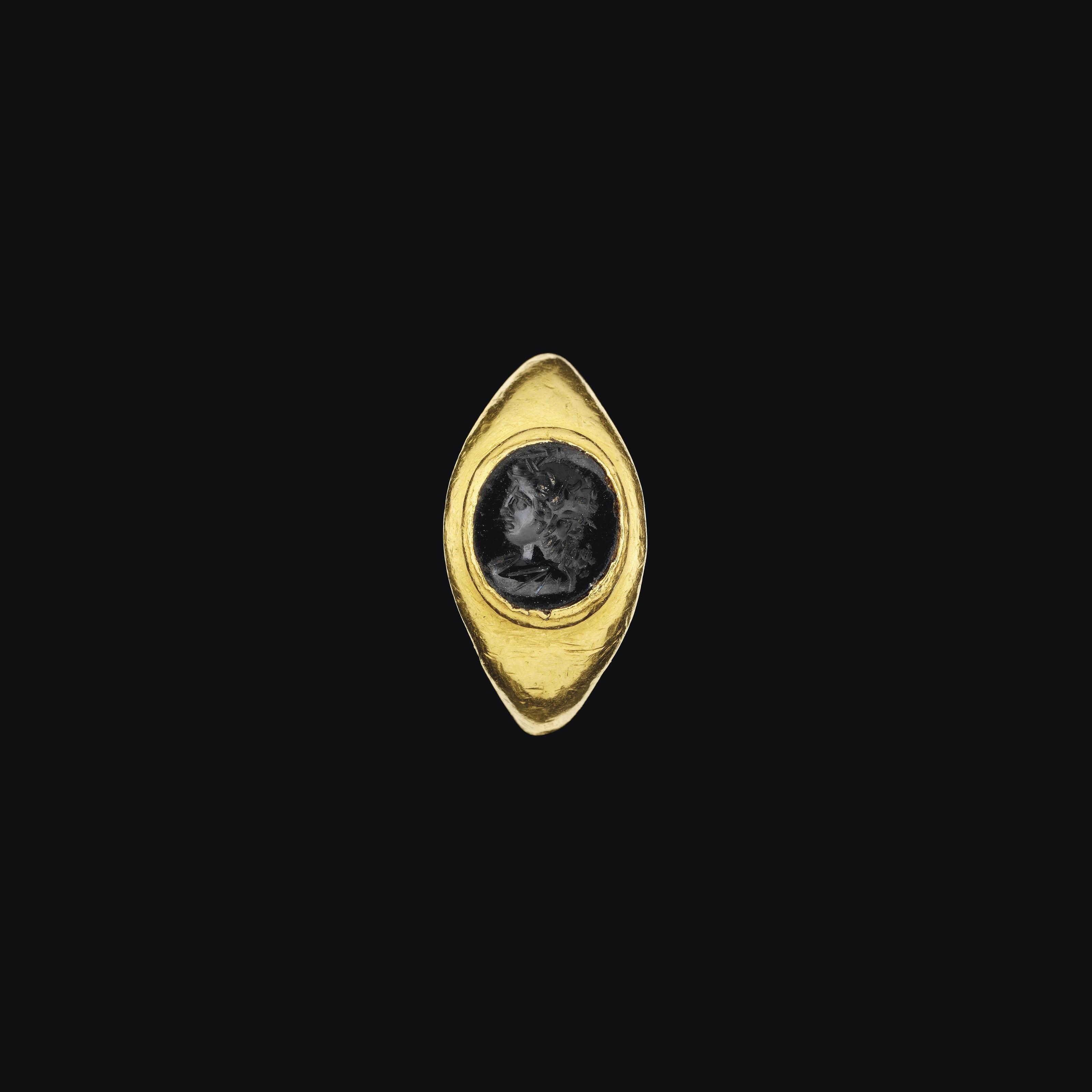 A ROMAN GOLD AND BLACK JASPER INTAGLIO RING , CIRCA 1ST