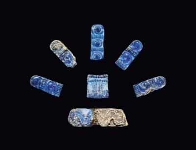 SEVEN MYCENAEAN BLUE GLASS BEA