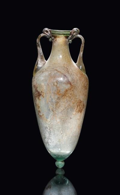 A ROMAN GREEN GLASS AMPHORA