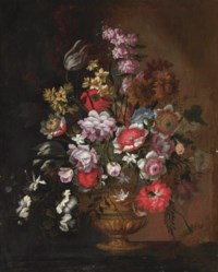 Poppies, peonies, tulips, capers, narcissi and other flowers in an urn on a ledge