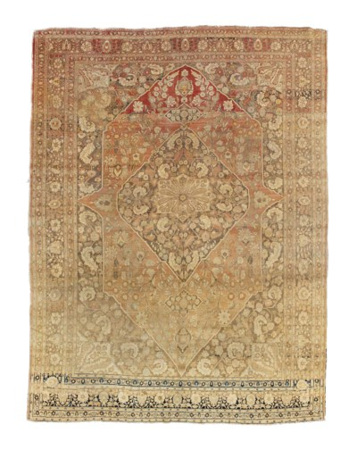 An antique Tabriz carpet