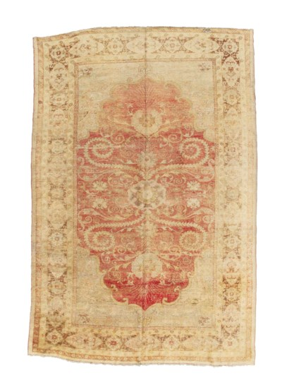An antique Ushak carpet & anti
