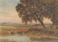 Cattle watering before a viaduct