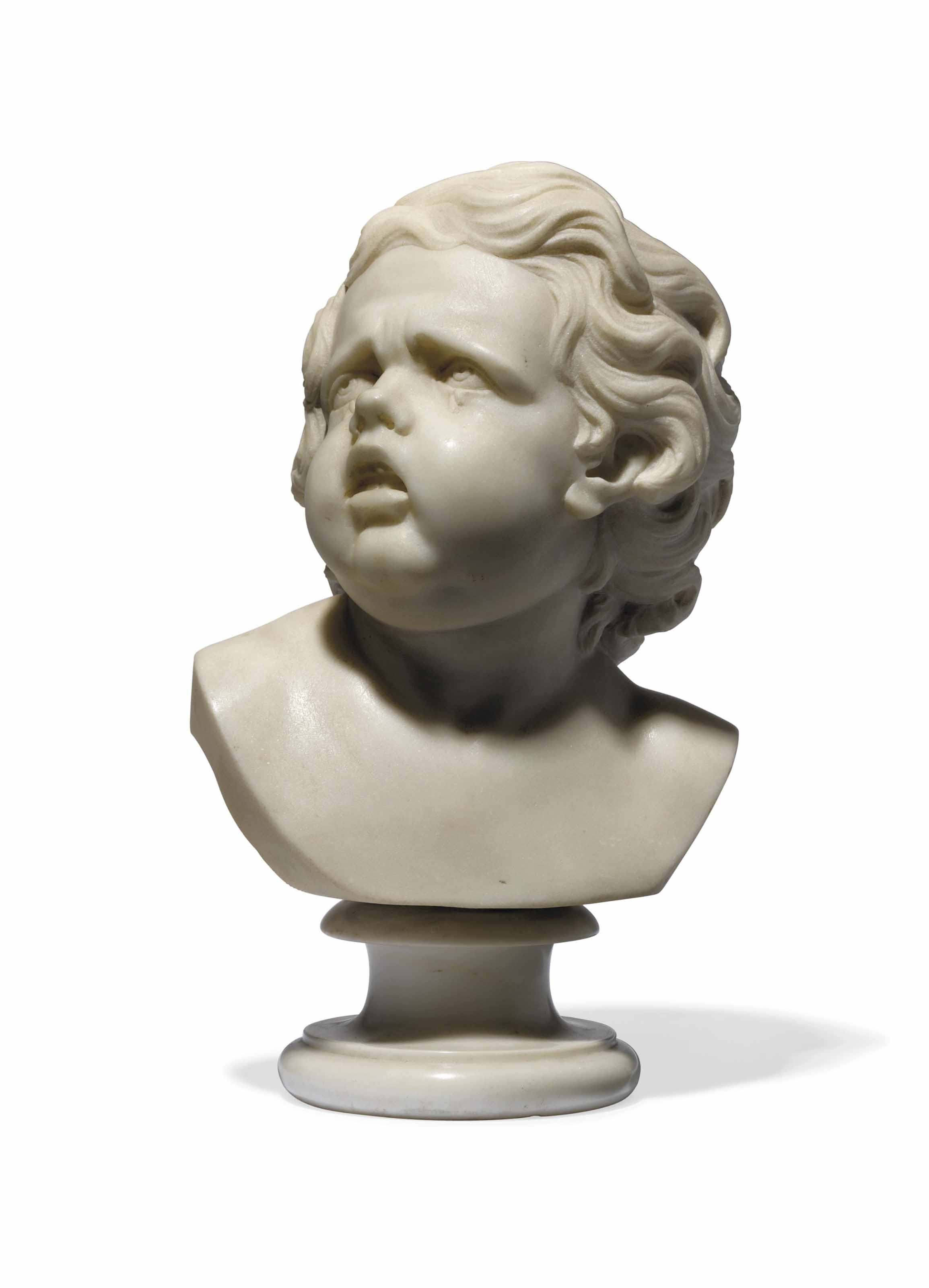 A CARVED MARBLE BUST OF A CRYI
