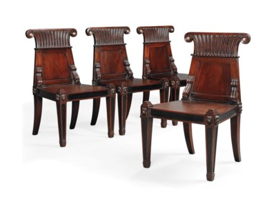 A SET OF FOUR MAHOGANY AND EBO