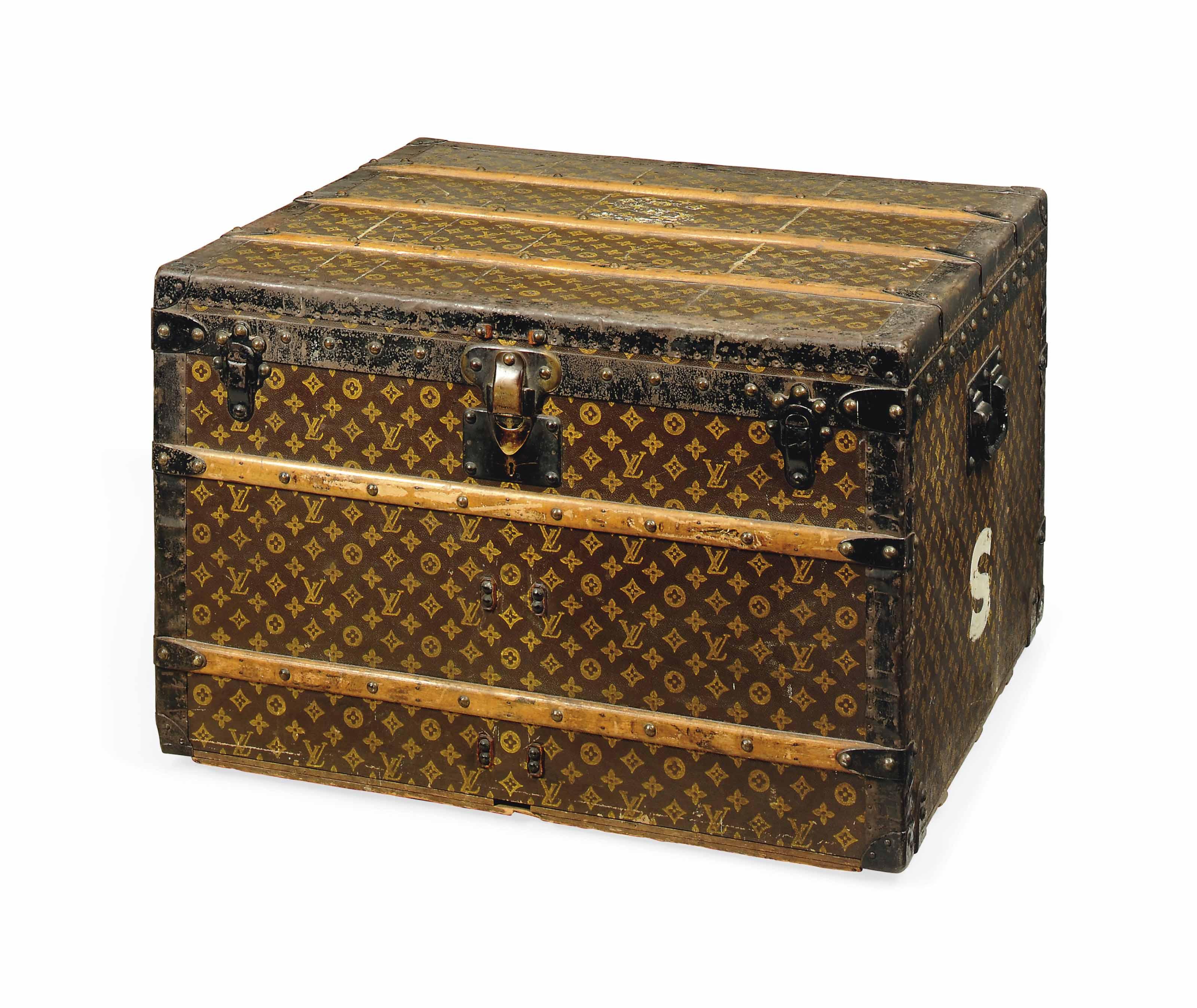A BOX TRUNK IN MONOGRAM CANVAS
