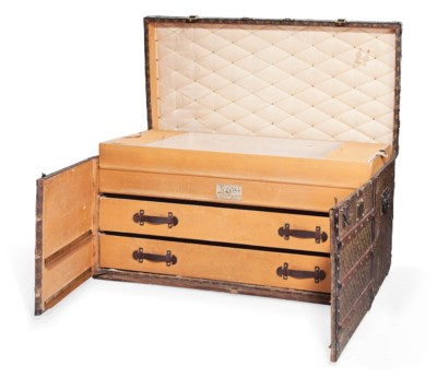 A TRUNK WITH DRAWERS IN MONOGR