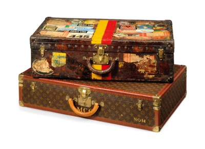 A HARD-SIDED SUITCASE IN MONOG