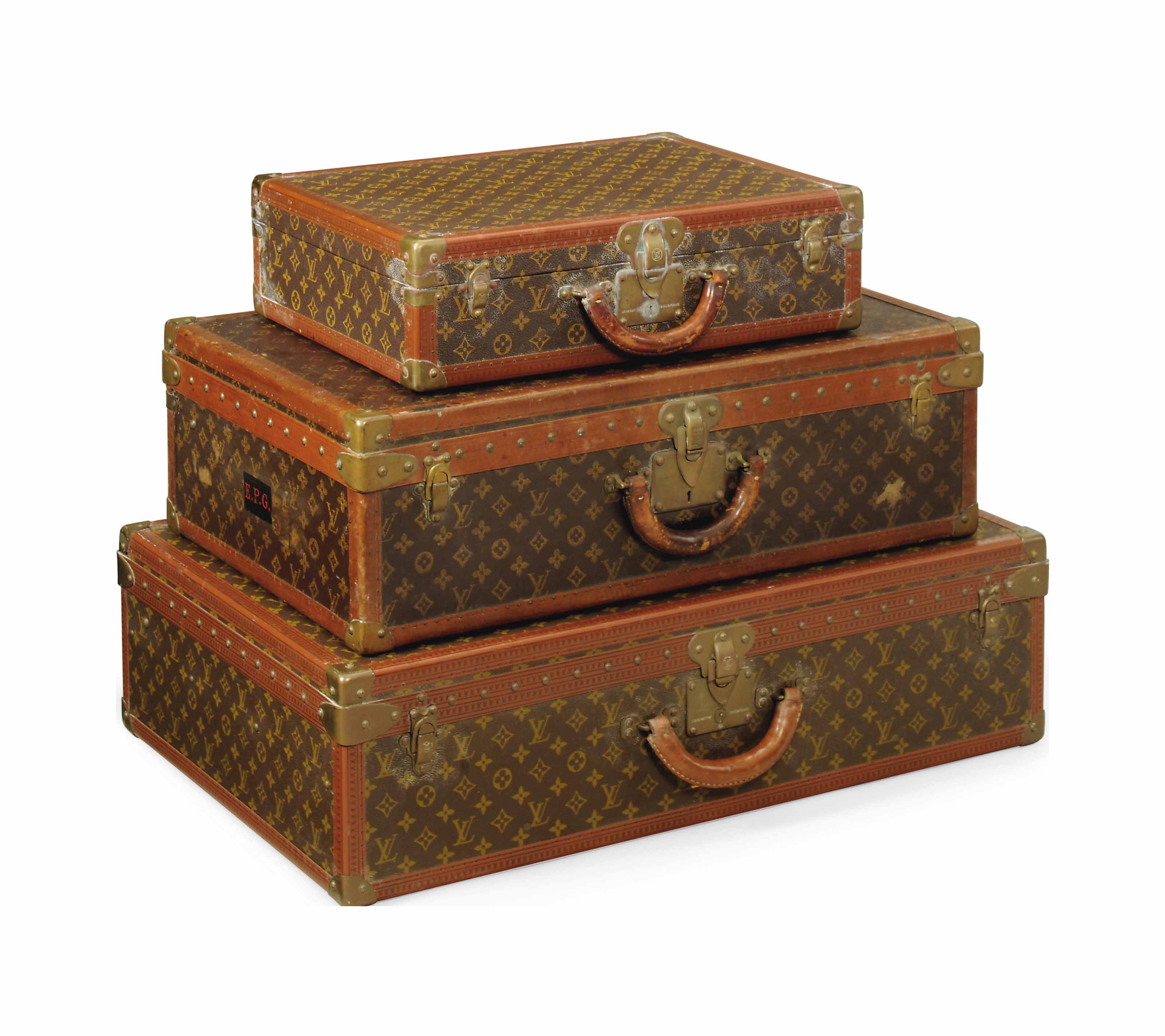 THREE HARD-SIDED SUITCASES IN