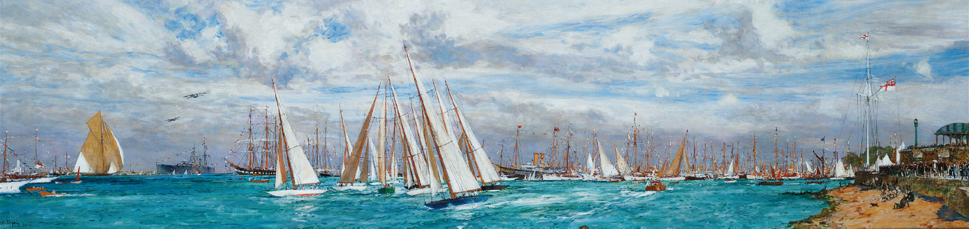 A one-design class crossing the starting line at Cowes Week, 1930, with the Royal Yacht Victoria and Albert (III), with H.M. George (V) aboard, lying in Cowes Roads, other yachts dressed overall and spectators lining the foreshore before the Royal Yacht Squadron