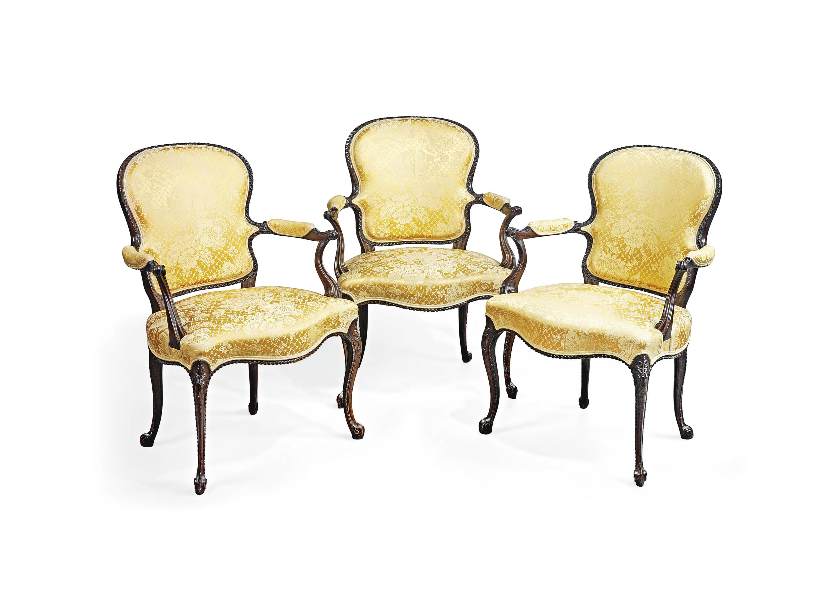 A SET OF THREE LATE VICTORIAN MAHOGANY ARMCHAIRS