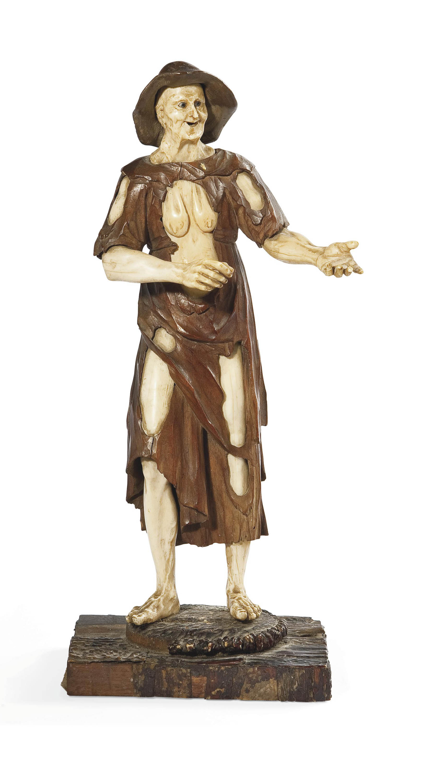 AN AUSTRIAN WALNUT AND IVORY FIGURE OF A PEASANT